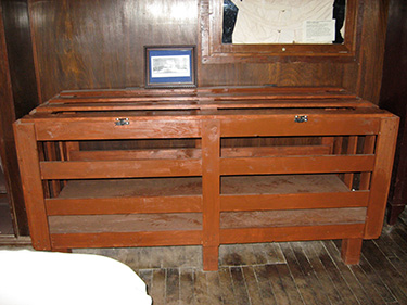 """An """"Utica crib"""" used for the transport and restraint of patients."""