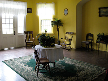 """Trustworthy"" patients were house in the wards on the ground floor. This is the restored sitting room, as it would have appeared in the late 1800's."